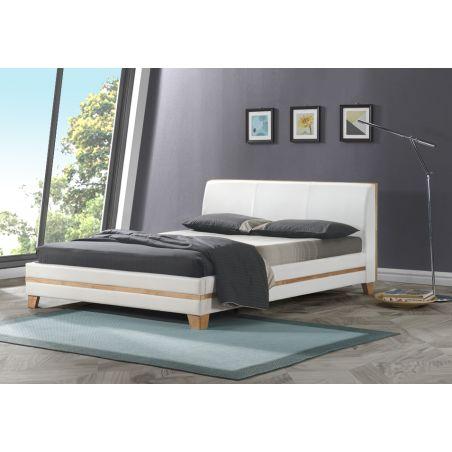 מיטה עץ מלא מרופדת
