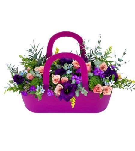 סידור פרחים בסל צבעוני